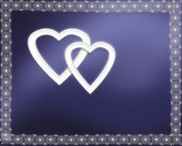 Two silver hearts on blue background Royalty Free Stock Photo