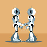 Two silver humanoid robots shaking hands Stock Image