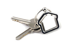 Two silver keys with metal house figure Royalty Free Stock Images