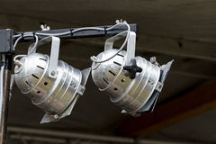 Two silver PAR spotlights on the stage of an outdoor festival. Two used PAR spotlights in silver on a lighting system for the stage of an outdoor festival Royalty Free Stock Photography
