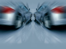 Two Silver Sports Cars in motion Royalty Free Stock Photo