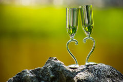 Two wedding glasses on stone in summer garden Royalty Free Stock Images
