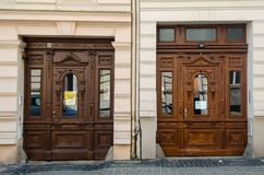 Two similar ancient decorated doors in Gorlitz, Germany. Front view stock photo