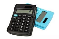 Two similar calculators different colors Stock Photos