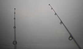Two similar fishing rods Royalty Free Stock Image