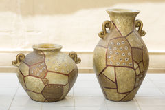 Two similar ornamented pots standing on the floor Royalty Free Stock Photography