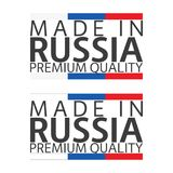 Two simple vector symbols Made in Russia, two signs with Russian. Tricolor isolated on white background, premium quality labels Royalty Free Stock Photo