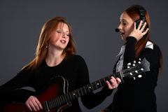 Two singing woman Royalty Free Stock Images