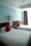 Two single bed in a bedroom. Interior of a hotel suite room showing two single bed Royalty Free Stock Images
