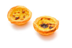 Two single portuguese egg tarts Royalty Free Stock Images