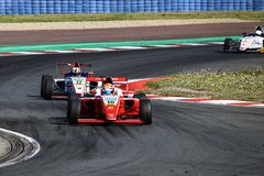 Two single-seater cars during German Formula 4. Oschersleben, Germany, April 26, 2019: two single-seater cars during German Formula 4 at the Motorsport Arena stock photos
