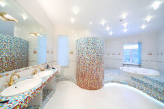 Two sinks and big mirror in spacious bathroom with jacuzzi stock photography