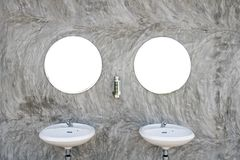 Two Sinks with Two Mirror. On The Concrete Wall royalty free stock photo