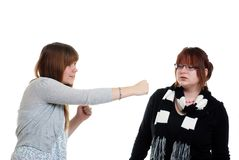 Two Sisiters fighting. Isolated Two Sisiters fighting on a white background Stock Images
