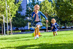 Two sister girls friends running holding hand in Royalty Free Stock Photo