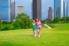 Two sister girls friends walking  in urban skyline Royalty Free Stock Photography