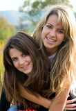Two sister having fun. Outdoor portrait of Two sister having fun royalty free stock images