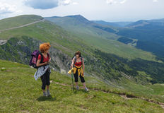 Two sister hiking into the mountains Royalty Free Stock Photography