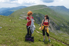 Two sister hiking into the mountains Royalty Free Stock Images