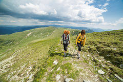 Two sister hiking into the mountains Stock Photo