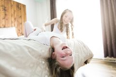 Two sister lay bed at home Stock Image