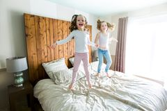 Two sister lay bed at home Royalty Free Stock Photography
