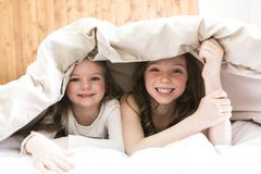 Sister Relaxing Together In Bed Royalty Free Stock Photography