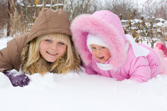 Two sisters. On the snow Stock Photos
