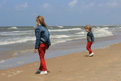 Two sisters. Two blond sisters on sandy Stock Image