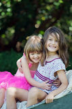 Two sisters. Two loving little girls or sisters on a beautiful day, smiling and having fun; concept of love and happiness , family or friendship Royalty Free Stock Photo