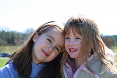 Two sisters. Two young girls spending time together Stock Images
