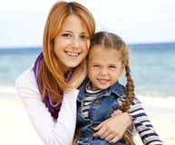 Two sisters 5 and 22 years old at the beach Royalty Free Stock Image