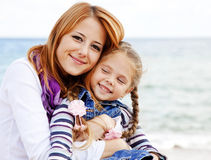 Two sisters 5 and 22 years old at the beach Royalty Free Stock Photography