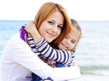 Two sisters 5 and 22 years old at the beach Royalty Free Stock Photo