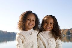 Two sisters. Two beautiful mixed race sisters enjoying the park Royalty Free Stock Photo