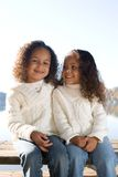 Two sisters. Two beautiful mixed race sisters enjoying the park Royalty Free Stock Images
