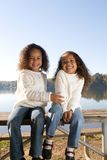 Two sisters. Two beautiful mixed race sisters enjoying the park Stock Photos