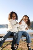 Two sisters. Two beautiful mixed race sisters enjoying the park Royalty Free Stock Photos