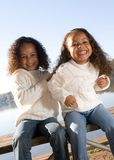 Two sisters. Two beautiful mixed race sisters enjoying the park Stock Photo