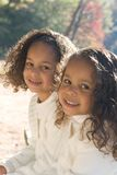 Two sisters. Two beautiful mixed race sisters enjoying the park Royalty Free Stock Image