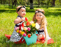 Two sisters. Adorable little child girls with bouquet of flowers on happy birthday. Royalty Free Stock Photos