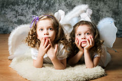 Two sisters with angel wings Royalty Free Stock Photos