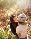 Two sisters in autumn forest Stock Images