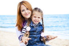 Two sisters at the beach in sunny autumn day Stock Photography