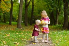 Two sisters on beautiful autumn day Royalty Free Stock Photo