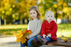 Two sisters on a beautiful day in autumn Royalty Free Stock Photography