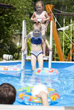 Two sisters in bikini near swimming pool. Hot Summer Royalty Free Stock Photo