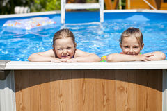 Two sisters in bikini near swimming pool. Hot Summer Royalty Free Stock Image