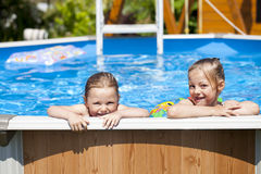 Two sisters in bikini near swimming pool. Hot Summer Stock Photography