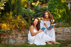 Two sisters and books Stock Photo
